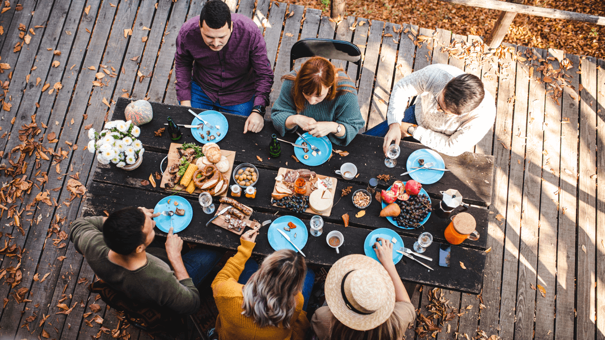 A family gathered around a table celebrating thanksgiving in other countries