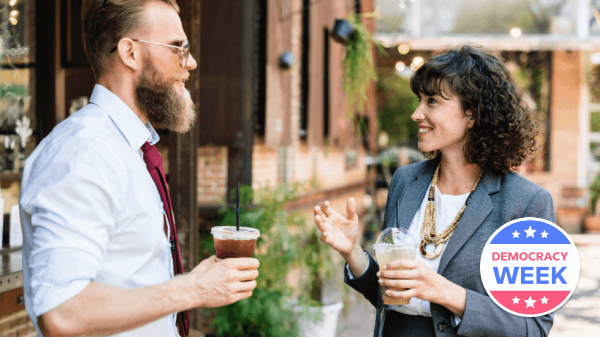 A man and a woman drinking coffee and learning how to talk about politics