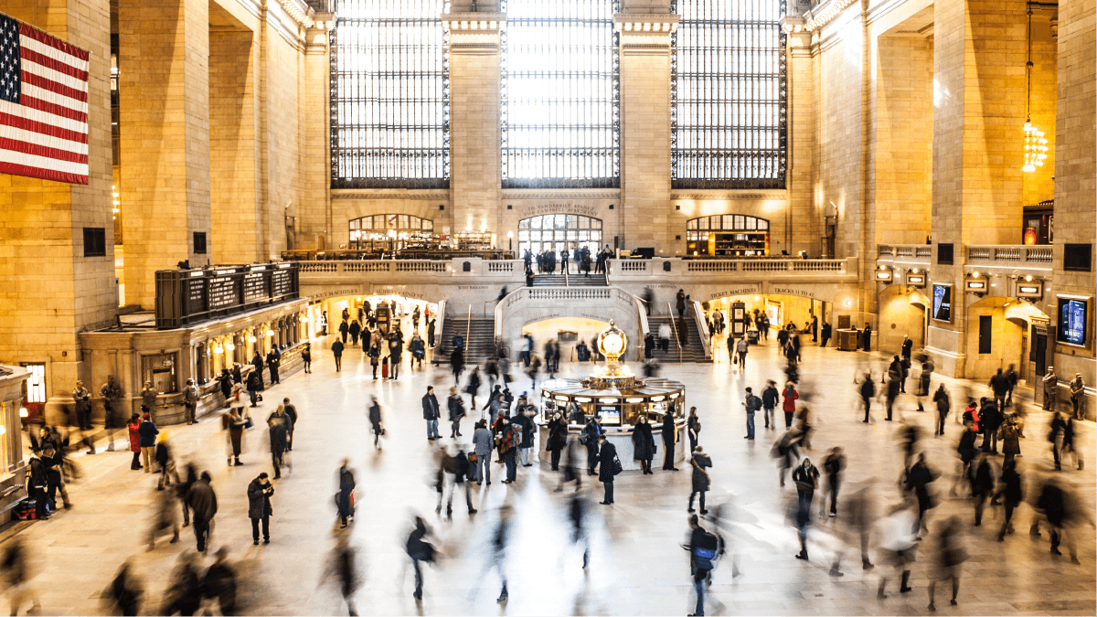 The languages in North America represented by a bustling scene of Grand Central Terminal in Manhattan, New York.