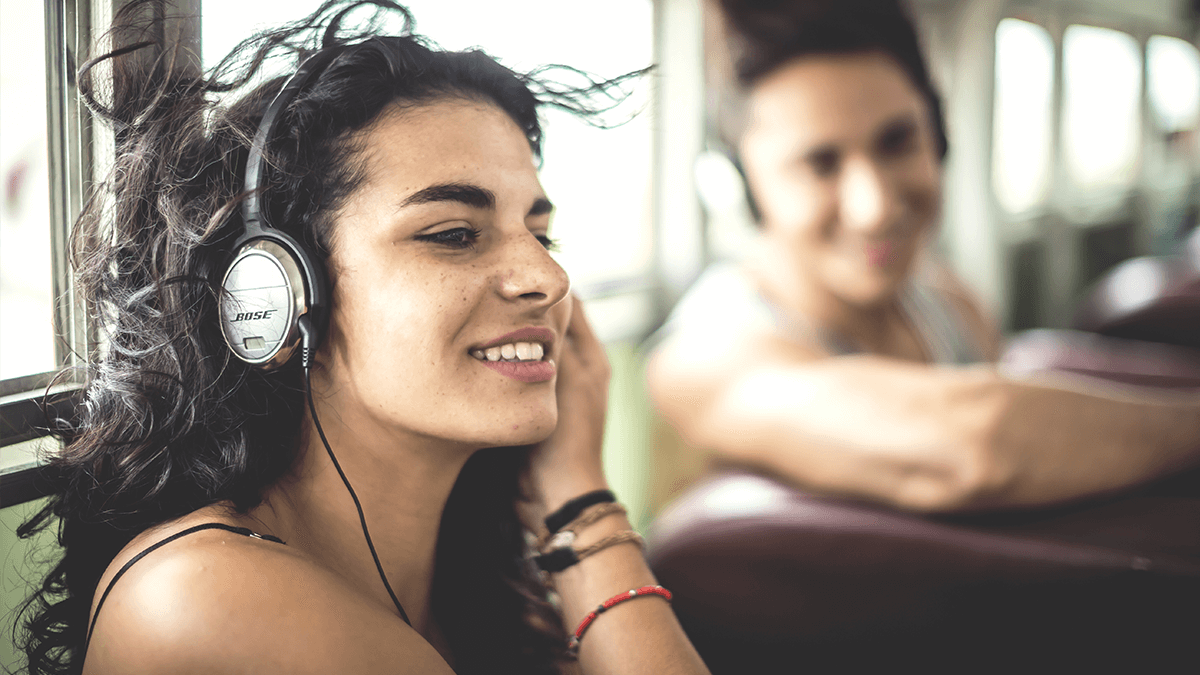 woman listening to music with headphones Swedish playlist