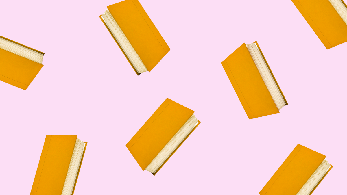 danish books floating on a pink background