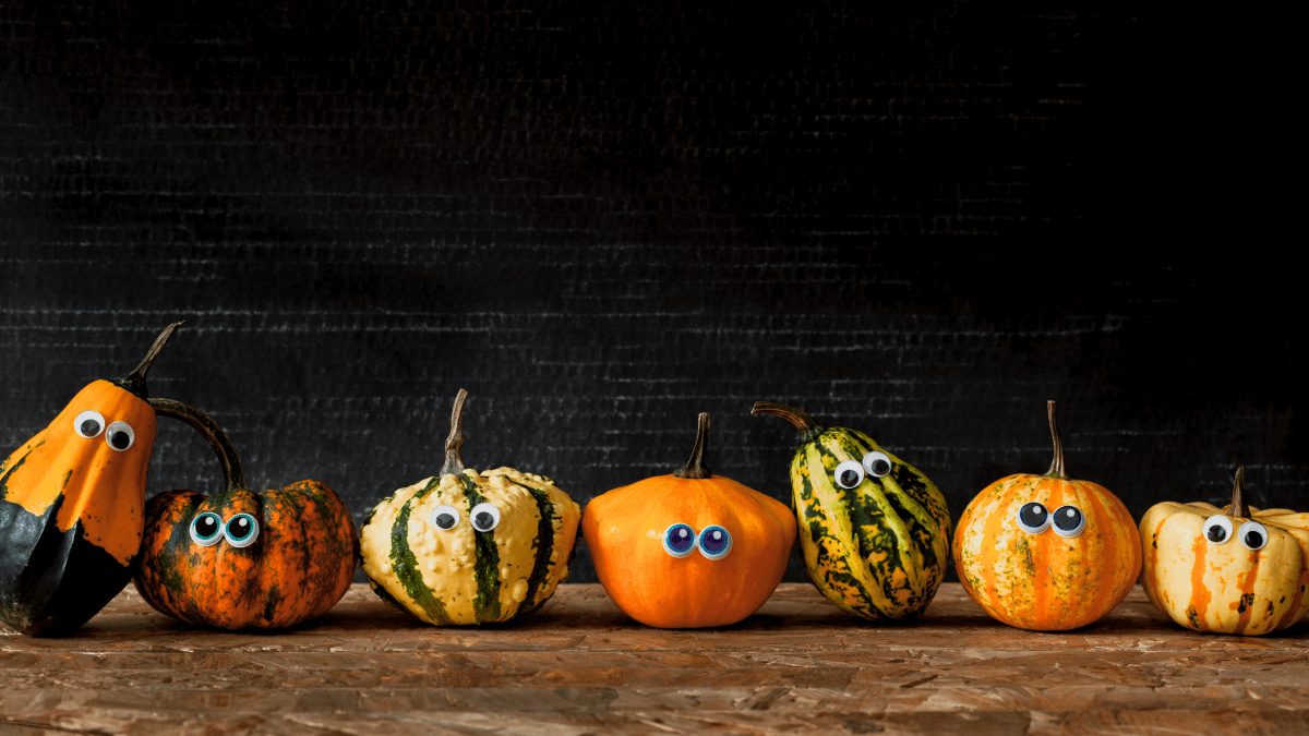 Gourds with googly eyes to represent spooky word origins