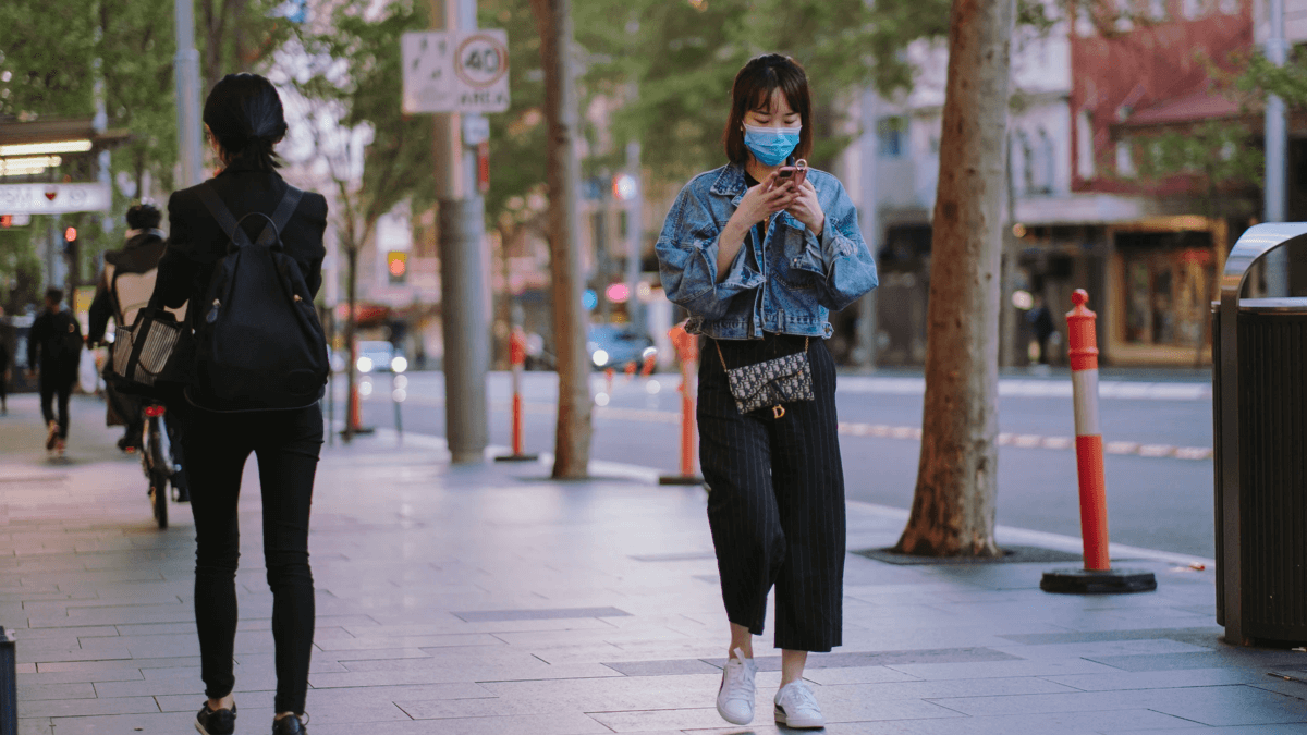A woman discovering that masks make communication more difficult
