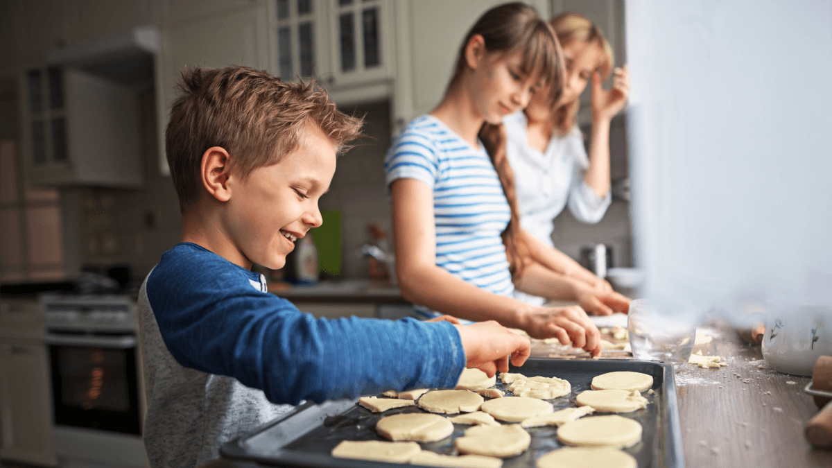 family in polish making pierogis together