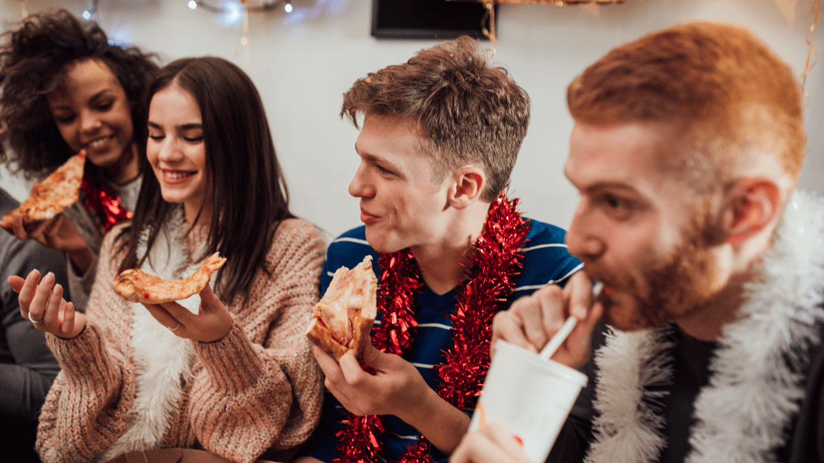 group of friends hanging out on couch eating pizza swedish mys