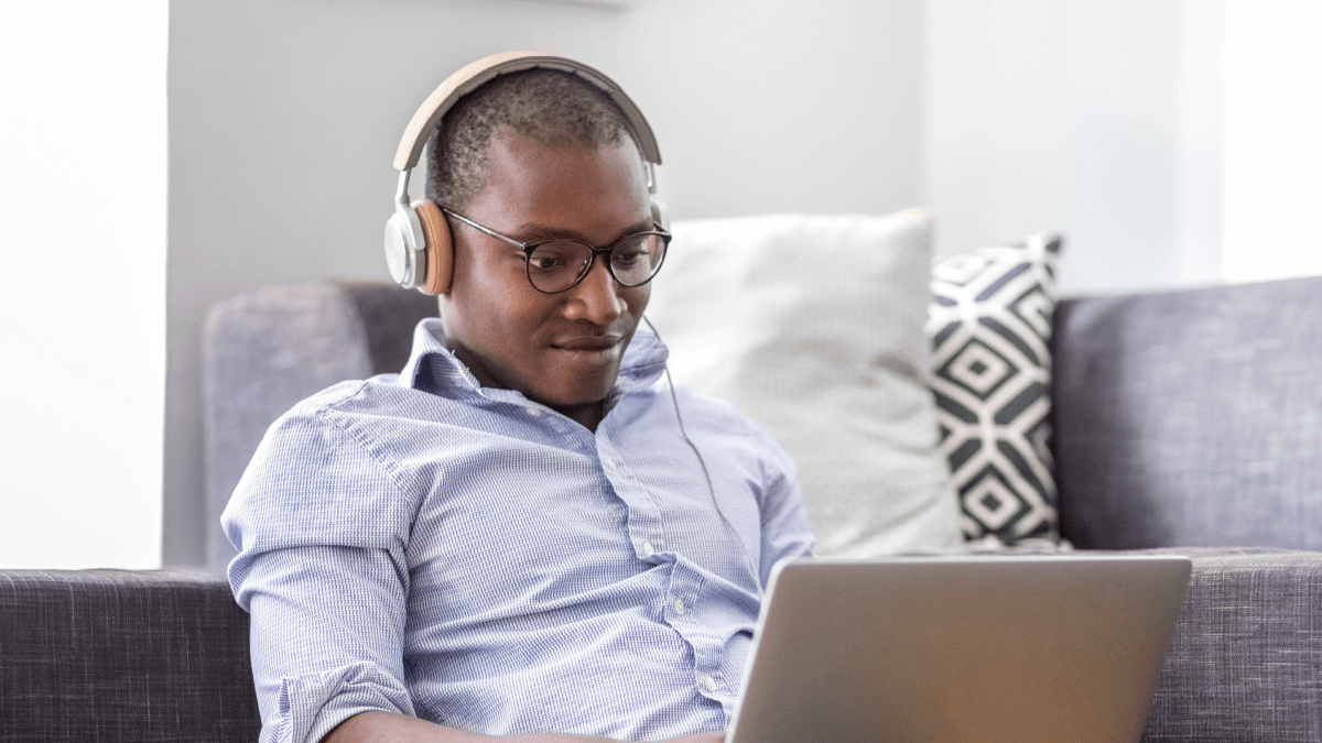 guy learning on laptop with headphones on couch ultra-beginner