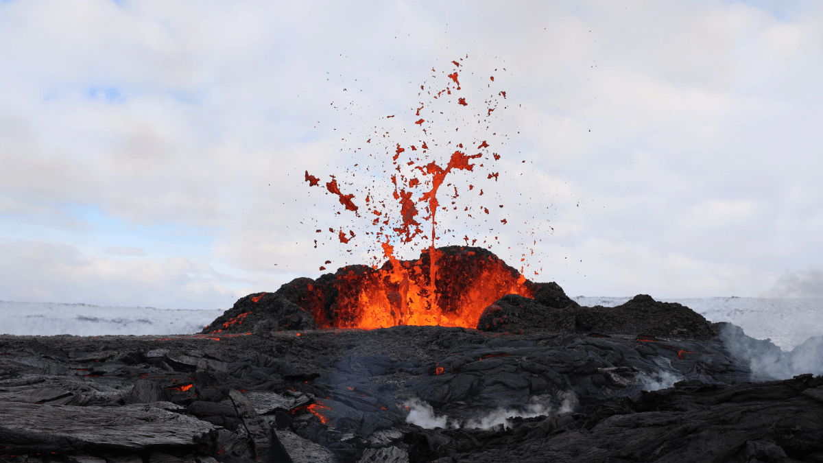 A volcano spewing lava both of which are English words that are actually Italian