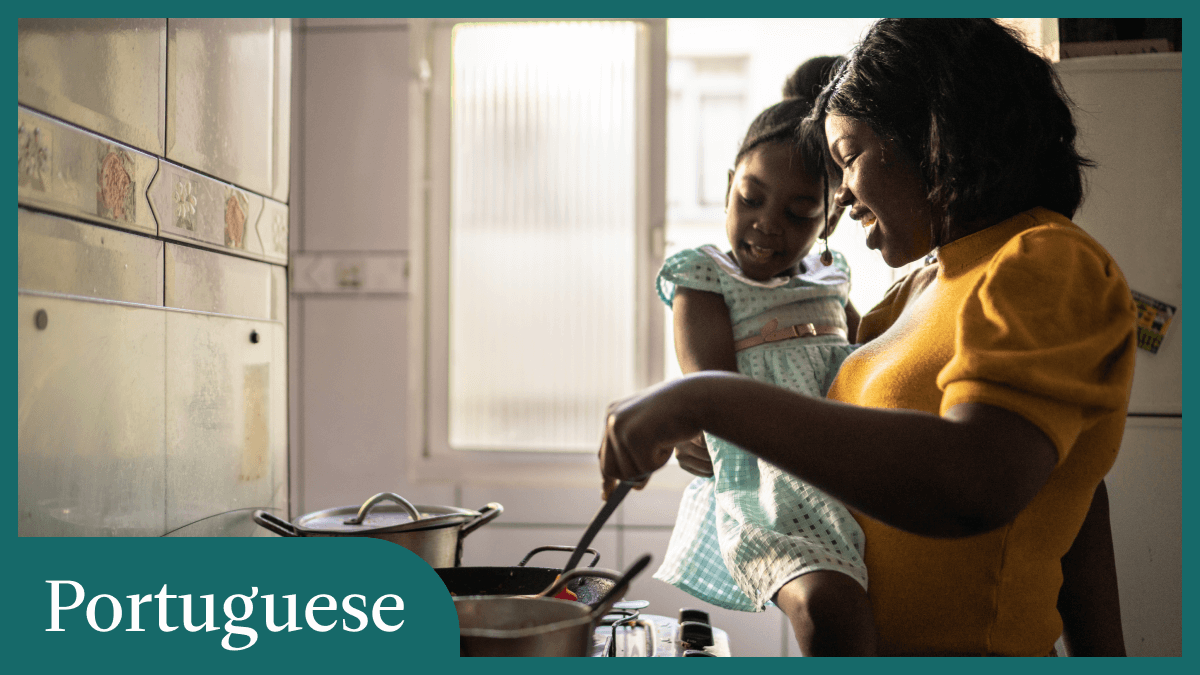 """Portuguese basics represented by a mother holding her daughter while cooking over a gas stove, in front of a window where the sun is shining in. The entire photo is surrounded by a steal frame, and in the bottom right corner is the word """"Portuguese."""""""