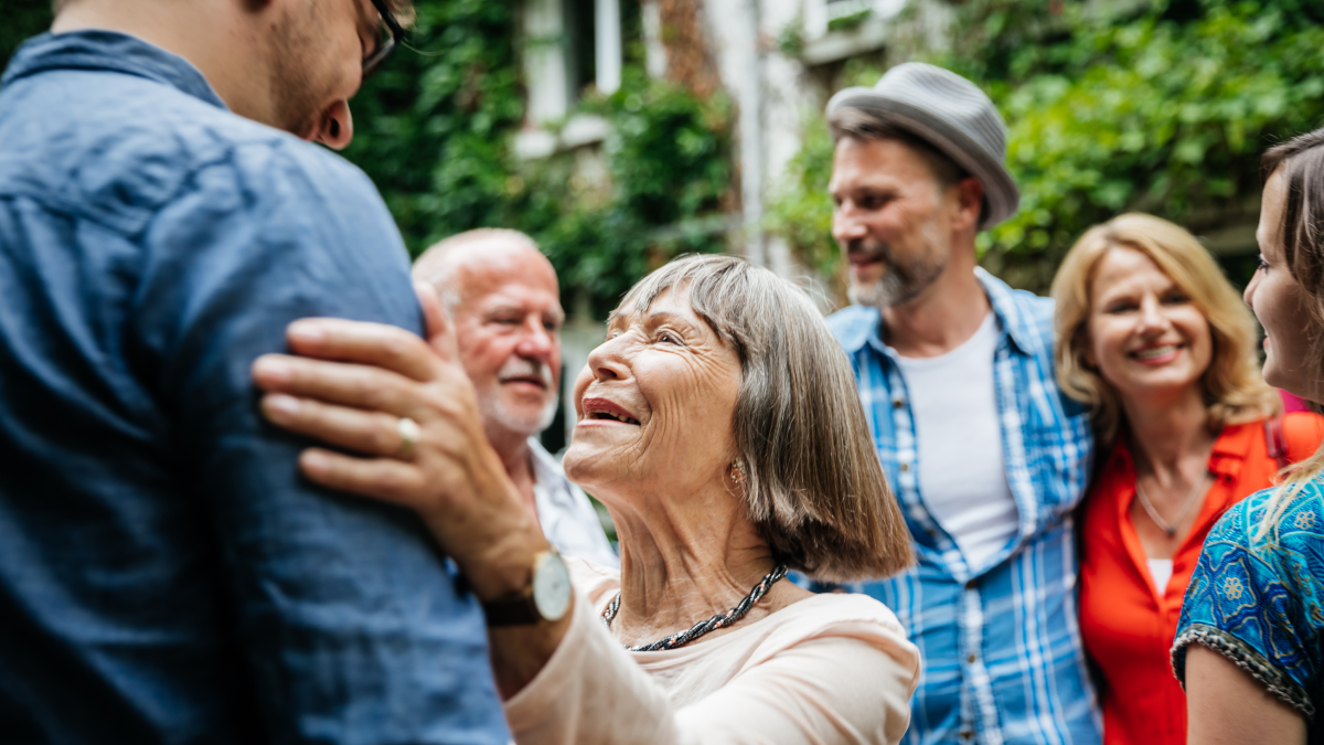 old woman dancing with a partner with some friends in the background vintage spanish slang