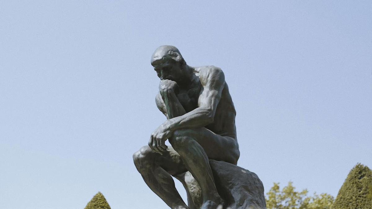 Myths about French represented by the Thinker from the garden of the Rodin Museum in Paris